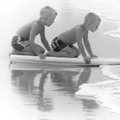 Two Little Boys on a Surf Board