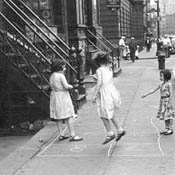 Little Girls Playing Hopscotch